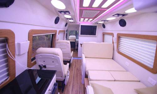 caravan-interior-bed-posh-seating-backside-view